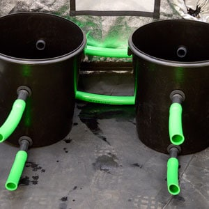 buckets with green hose on front